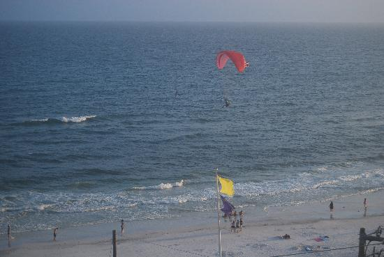 Surfside Resort: a guy flying over in a gas powered hang glider.  no red flags today.  Almost sunset time.