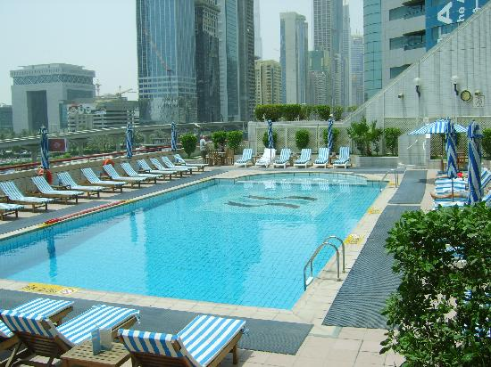 Hotel pool comfy sunloungers picture of crowne plaza for Nice hotels in dubai