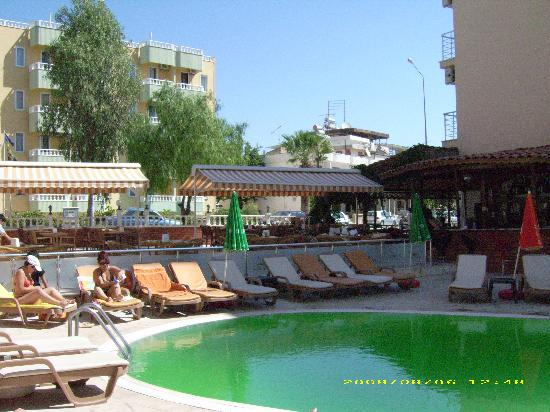 Duman Hotel: The pool area - normally blue water but turned a strange shade of green!