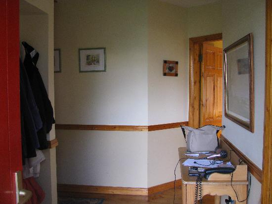 Old Killarney Cottages: Entry hallyway of type D single cottage, taken from front doorway. Note the hooks to hang jacket