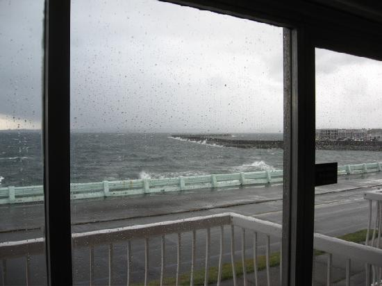 Watching storm waves lash the Ogden Point breakwater from the Surf Motel.