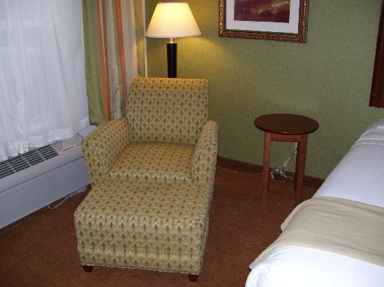 Holiday Inn Express Asheville: Comfy chair with ottoman and small round table