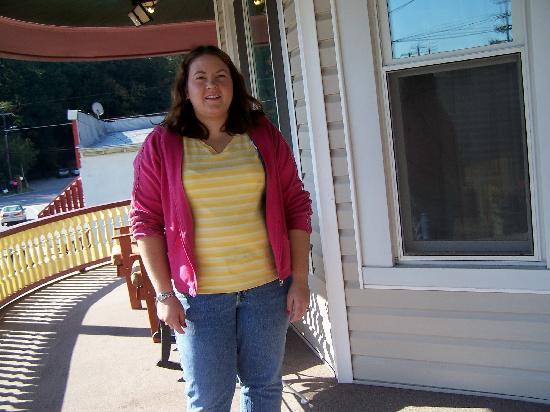 The Arnott House: Jeanette on round front porch