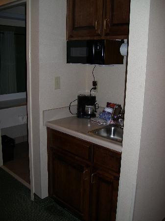 Auburn Place Hotels and Suites: Kitchen area with microwave, coffeemaker, sink with water filter, and mini-fridge in bottom cabi
