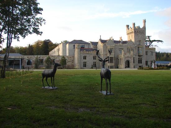 Lough Eske Castle, a Solis Hotel & Spa : Deer sculptures in the grounds with the main building behind