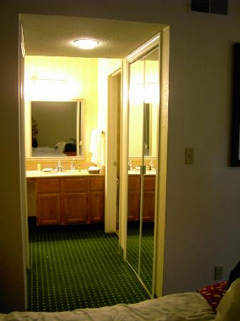 Residences at Daniel Webster: vanity area, bathroom off to the side