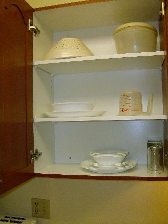 TownePlace Suites Denver Southeast: Kitchen cabinets have dishes but no pots or pans.