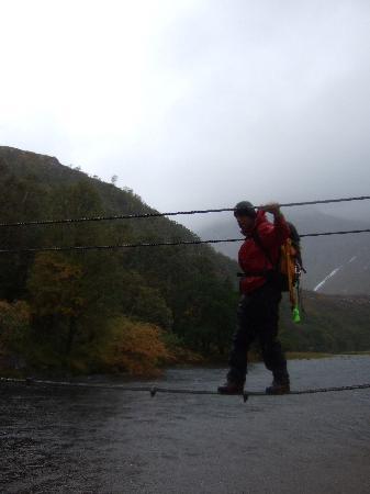 Steall Waterfall: Crossing the footbridge.