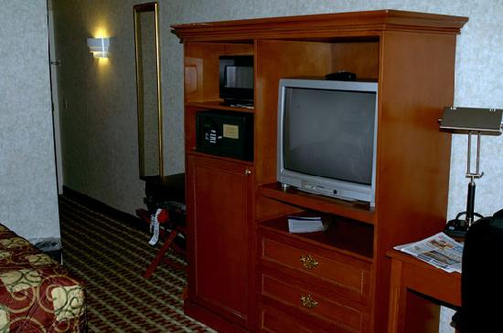 Baymont Inn & Suites West Lebanon : Dresser, refrig (hidden in cabinet), microwave, safe, & TV