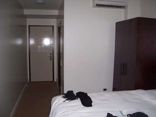 The Hotel 91: Bare walls, closet not fit to store much clothing at all!