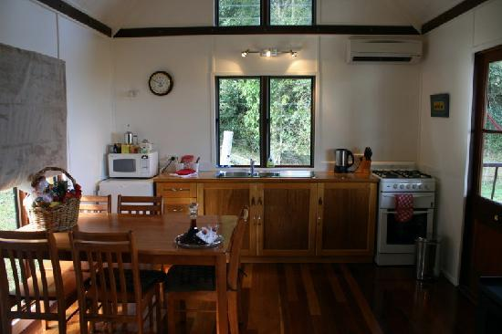 Half Moon Hide-Away: Kitchen & ining area with fireplace