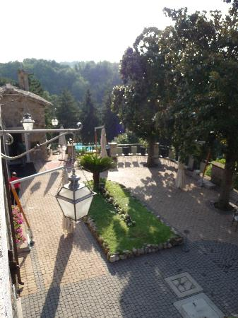 Castello della Castelluccia: view down the hill to the pool