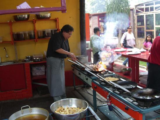 La casa de Don Cucho: don Cucho actually prepares the food in this action photo
