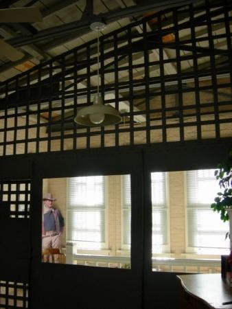 The OK Street Jailhouse : John Wayne just outside the bedroom...