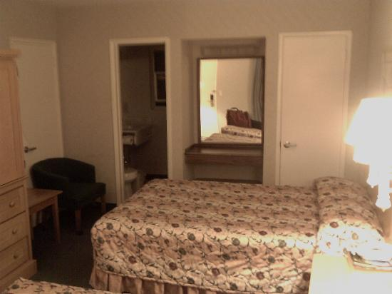 Fiesta Inn and Suites: tiny room crammed with furniture, notice the distorted make up area.