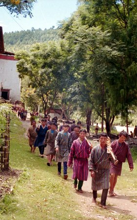Punakha, Butan: men wearing traditional gho