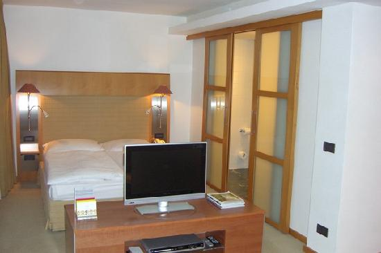 The Mandala Hotel Bedroom Area With Sliding Doors To Bathroom