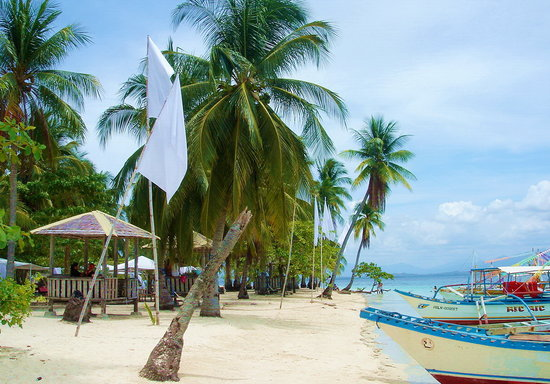 The best beaches Puerto Princesa - Shows a small beach in Honda Bay