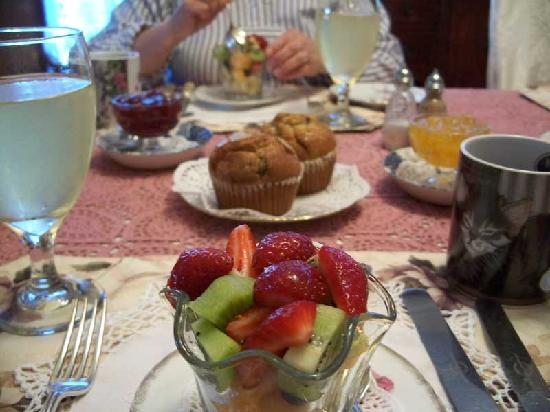 The Marmalade Cat Bed & Breakfast: fruit cup and muffins in back