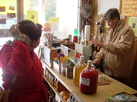 A.J. Gross & Sons Orchard: Cider being rung up on the register at Gross' Orchard.  The red bottle is cherry apple cider.