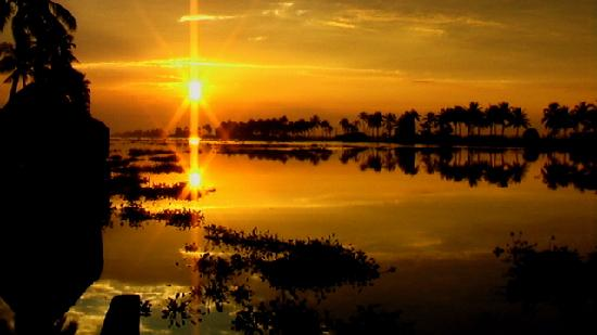 Alappuzha, India: Sunrise from the backwaters in Kerala.
