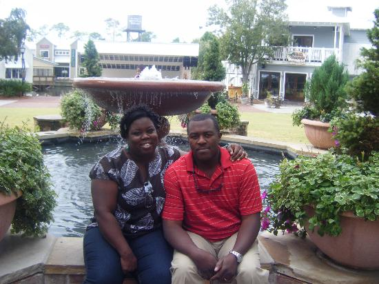 Village of Baytowne Wharf: hubby and I at the fountain of youth