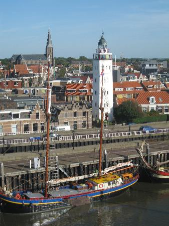 Harlingen Harbour Crane / Crane Hotel: lighthouse and town centre view