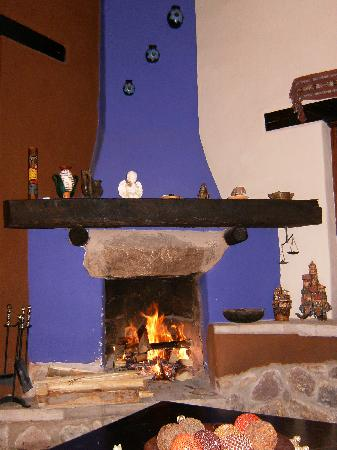 Kuychi Rumi: Fireplace in living room -- after a long day at Machu Piccu