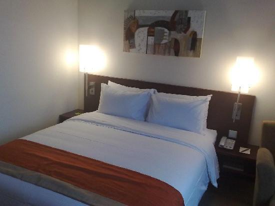Nice bed, Nice painting.