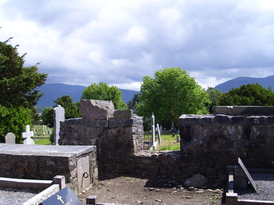 Aghadoe Church and Round Tower: Ogham stone and Carved crucifixion stone on tops of walls