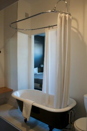 The Bathroom With The Old School Shower And Clawfoot Tub