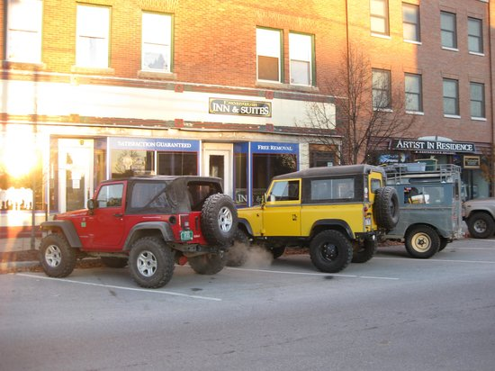 Enosburg Falls, VT: expedition vehicles parked in front of the inn