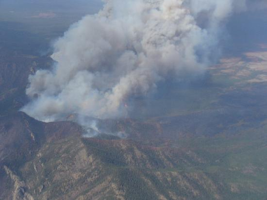 Inn of the Five Graces: Fire in Mountian from Plane
