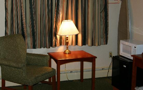 Skowhegan, ME: King Bed Room - Chair, ironing board, refridgerator/microwave