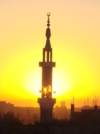 Amon Hotel Luxor: mosque at sunrise from hotel roof