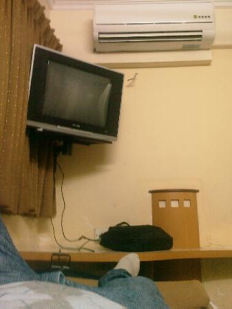Kamran Residency : between the bed and the tv there was about 30 cm space