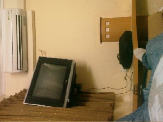 Kamran Residency: between the bed and the tv there was about 30 cm space
