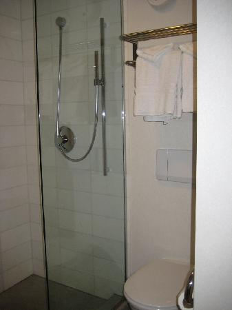 O Hotel: boutique room shower + toilet