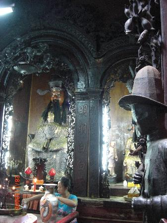 Emperor Jade Pagoda (Chua Ngoc Hoang or Phuoc Hai Tu) : the jade emperor and the two huge horses. ring the bells on their neck for luck