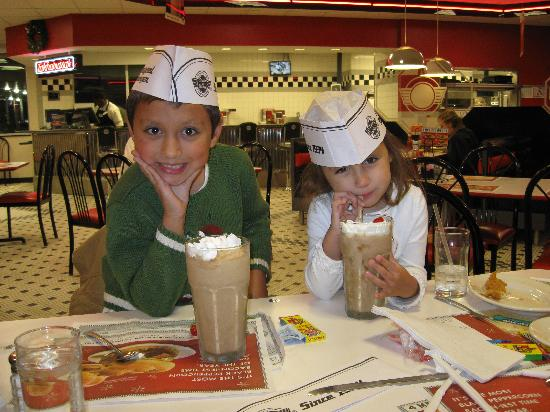 Kids drinking malts in dining room at steak 39 n shake in nw for Steak n shake dining room hours