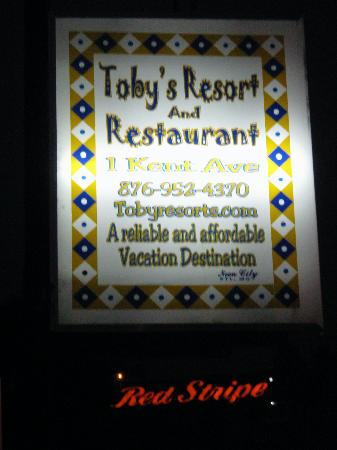 Toby's Resort: The Toby's sign with the Red Stripe sign in the background