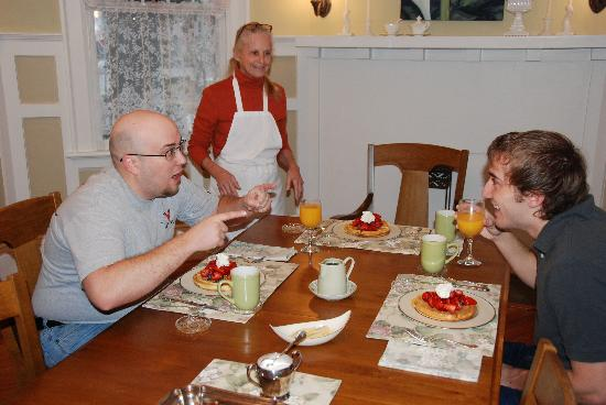 North Street Inn Bed & Breakfast: My two sons, with JoAnne, hamming it up at breakfast.  Check out the waffles