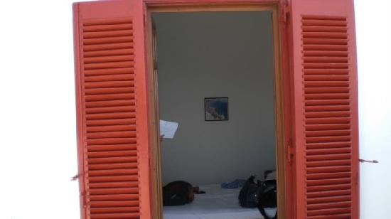 Artemis Hotel: Our room - from the balcony - complete with adorable red shutter doors.