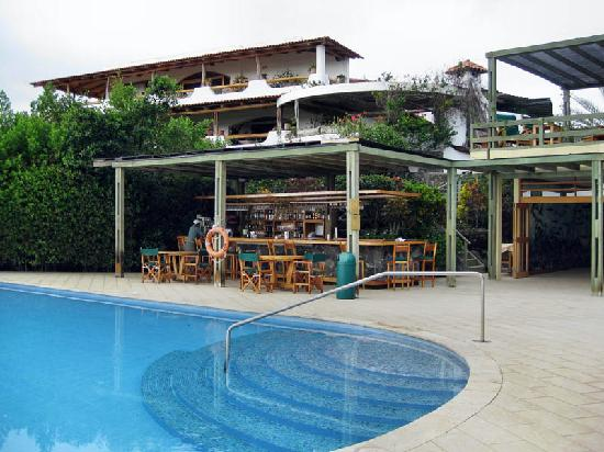 Finch Bay Eco Hotel: Bar area adjacent to dining and pool