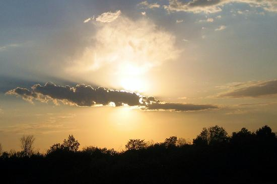 Illinois: Setting Sun Behind a Cloud in Jo Daviess County