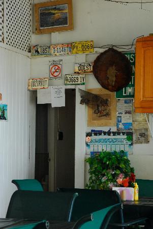 Stanley's : License plates over the restroom door