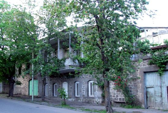in the center of Goris, most houses are stone and the streets lined with trees