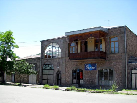 Goris, Armenia: some buildings have intricately decorated wooden balconies
