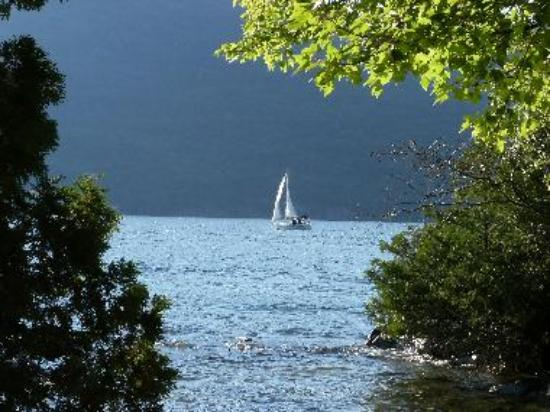 A sailboat on Lake George at Black Mountain Point