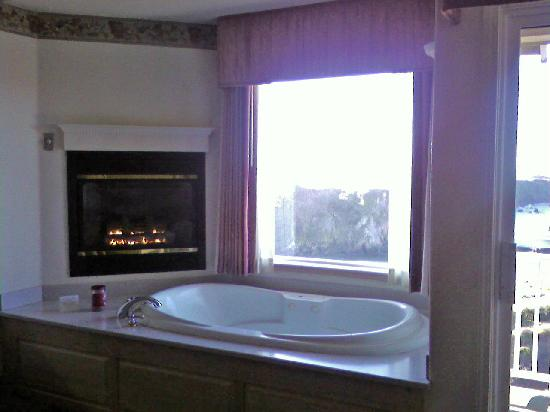 Hot tub right in the room - gas fireplace right next to it - window facing ocean